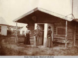 Mr. and Mrs. Wickersham (right) and woman friend in front of the Eagle cabin.