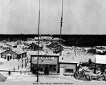 Fort Yukon (?).  H.E. Carter General Merchandise store in foreground.