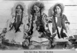 Three of girls with long braids of hair. All like this when we went there, 1921.