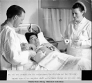 Dr. White and Nurse Britten do a dressing. U.S. I. O. Hospital - Bethel 3/1940.