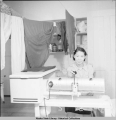 Laundress at work in hospital laundry.U.S. I. O. Hospital - Bethel 3/1940.