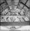 Oomiaks, [Umiaks] stored upside down. Little Diomede Island, 3/1942.