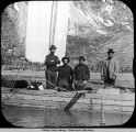 Four prospectors in hand-hewn scow, with sail, ca. 1897.