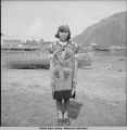 Thlingit ceremonial costume worn by school girl. Government school - Douglas, Alaska, 5/1940.