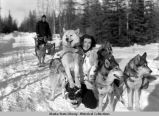 Mary Joyce with sled dogs, ca 1936.