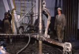Oil laborer throws chain.