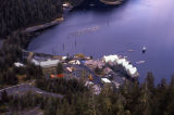 Aerial of salmon hatchery with holding pens.