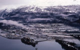 Aerial of Valdez, winter mtns and calm water.