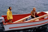 Benn Levine and Billy Day in red and white skiff, workers from the Homer Area Recovery Coalition...
