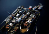 Aerial of boat cleaning facility dry dock, cleaning oil spill vessels after demobilization