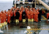 The Senior Seminar dress down in survival suits and form on the deck for group picture.