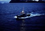 Aerial of tanker pilot boat heading back towards Valdez after its escort.