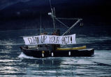 Banner waving commercial boat.