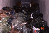 Open Lynden transport trailer with numerous bags of spill carcasses.