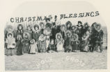 "Photo postcard reading ""Christmas blessings"" and showing community members from Holy..."