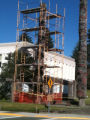 Scaffolding erected around totem poles