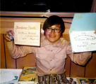Willie Nickoli proudly showing off his certificates.