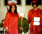 Igiugig first high school graduates Marie Nelson and John Zackar. Blind Gramma is with them.