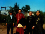 From left to right: Man in red robe is Father Micheal Oleksa. The last man to the right is Father...