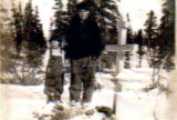 Mary with Sava standing next to Mary's grandfather's grave.