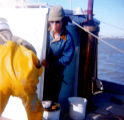 Wassie Apokedak with his father Evon on their fishing boat Anna A fishing in Bristol Bay.