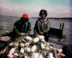 Yako Nickoli with his younger brother Tim on their fishing boat T-J, in Naknek.