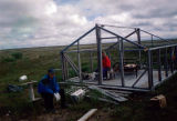 Fewnia Nickoli with her son, Willie building their cabin on Johnson Hill during the fishing season.