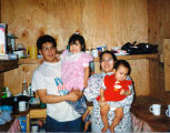 Gregory Sr., Renae, Sharolynn, and Gregory Jr. Zackar in Kokhanok during Russian Orthodox...