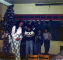 Maria Nelson with Gusty Tallepalek front of class during a Christmas play.