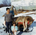 Annie Wilson and her daughter Annette standing near a wolf that Georgie caught.