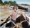 "Mary Apokedak in a boat with a caribou on the ""Old Levelock"" dock."