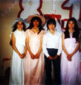Eighth grade graduation for Annette Wilson, Helen Zackar, Sergie Chukwak, and Martha Olympic.