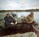 Gonnie Andrew with Alex Wassillie with a brown bear.