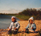 "Terry Mann and her sister Tammy on the beach of ""Airplane Lake""."