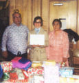 Raymond Apokedak with his parents Evon and Stephentia Apokedak at his eighth grade graduaion from...