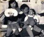Annie Nowatak, holding Annette Wilson, and Alica Zackar holding her daughter, Helen, pose for a...