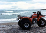 Mike Sr. and Dallia Andrew's new three wheel ATV sits alone on the beach of Igiugig.