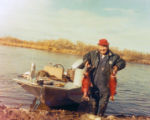 Mike Andrew Sr. carrying his red salmon catch from Branch River.