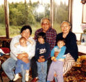 Family members holding three daughters of Julie Salmon.