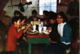 Children eating first at a names day lunch.