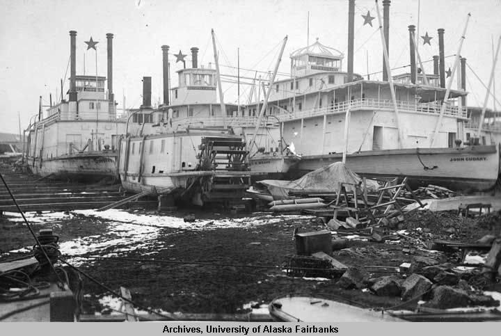 Three vessels in dry dock: Klondyke, Portus B  Weare, John